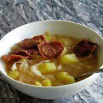 Суп из квашеной капусты с чипсами из салями