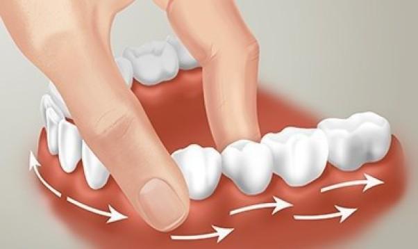 Массаж десен помогает предотвратить стоматологические заболевания